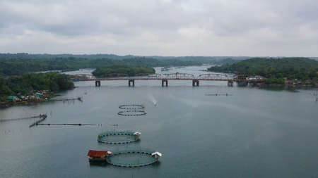 Aerial view of fish ponds for bangus, milkfish. Fish farm, top view. large scale traditional floating fish farms.