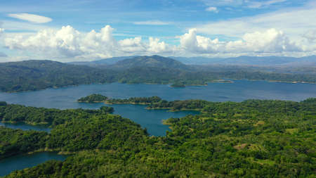 Beautiful landscape with green hills, top view. Azure Pantabangan lake among the hills. Lake in the mountains. Philippines, Luzon.