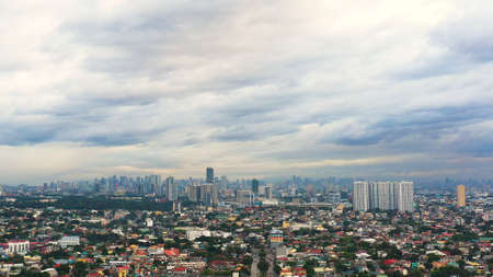 Skyscrapers and business centers in a big city Manila. Urban aerial landscape. Modern metropolis in Asia, top view.