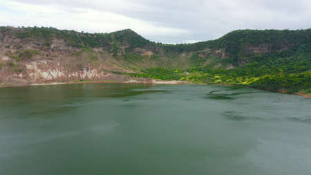 Scenery of Crater lake on the top of Taal volcano. Aerial drone. Green lake, Taal Volcano
