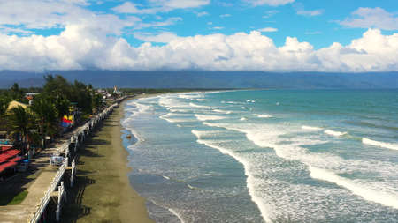 The coast with hotels and tourists, a famous place for surfing in the Philippines, top view. Secret Surf Capital Of The Philippines. Sabang Beach, Baler, Aurora, Philippines.
