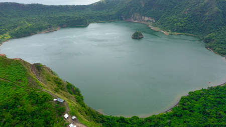 The smallest volcano in the Philippines is Taal with a green crater lake, aerial view. Tagaytay, Philippines. Green lake- Taal Volcano