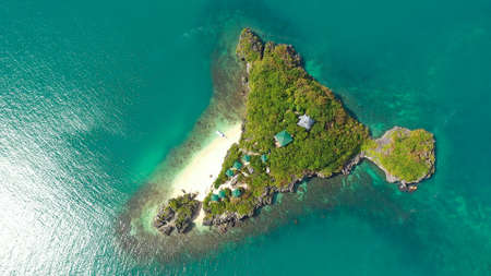 Beautiful beach on a tropical island with tourists, aerial view. Lopez Island, Hundred Islands National Park, Pangasinan, Philippines. Alaminos. Summer and travel vacation concept