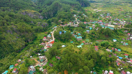 Houses and streets of a mountain town, top view. Aerial view town of Sagada, located in the mountainous province of Philippines.