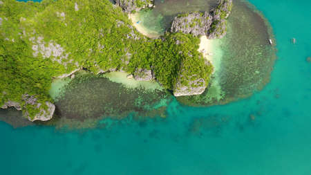 Tropical islands Kagbalinad and blue sea, aerial view . Caramoan Islands, Philippines. Rocky islands with trees. Summer and travel vacation concept. Rocky island with rainforest