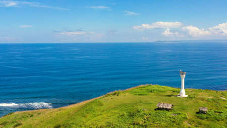 Basot Island, Caramoan, Camarines Sur, Philippines. Lighthouse on a hill by the sea, view from above . Beautiful landscape with a green island. Summer and travel vacation concept.