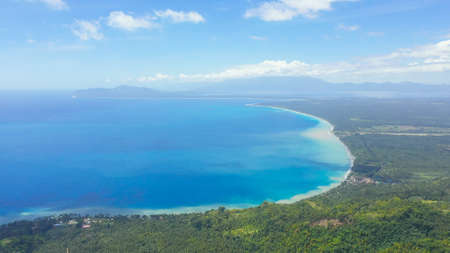 Mindanao island covered with rainforest. Blue sea and beaches in the Philippines. Zdjęcie Seryjne