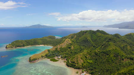 Famous Tourist Site: Sleeping Dinosaur Island located on the island of Mindanao, Philippines. Aerial view of tropical islands and blue sea.