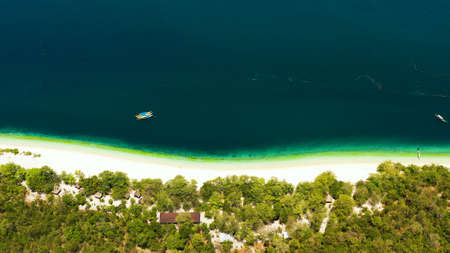 Tropical island with beautiful beach and turquoise water view from above. Great Santa Cruz island. Zamboanga, Mindanao, Philippines. Zdjęcie Seryjne