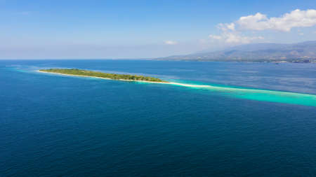 Aerial view of Seascape with beautiful beach and tropical island Little Santa Cruz. Zamboanga, Mindanao, Philippines.