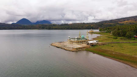 Aerial drone of Mosque on the shore of lake Lanao. Mindanao, Lanao del Sur, Philippines.