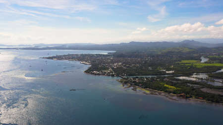Panorama of the city of Surigao against the background of the sea and mountains. Surigao City, Surigao del Norte.