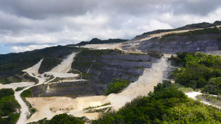 Open pit limestone quarry in the mountains of Bohol Island, Philippines. limestone quarry view from above.