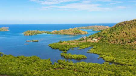 Tropical island with sandy beach on the Zamboanga Peninsula. Sallangan Islands, Simoadang Island. Mindanao, Philippines.