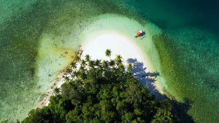 Aerial drone of Seascape with beautiful beach. Britania Islands, Surigao del Sur, Philippines.