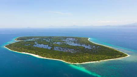 Tropical landscape with a beautiful beach in the blue water and Great Santa Cruz island. Zamboanga, Mindanao, Philippines.