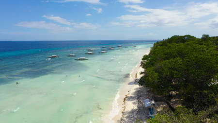 Aerial view of tropical beach on the island Panglao, Philippines. Seascape with beach.