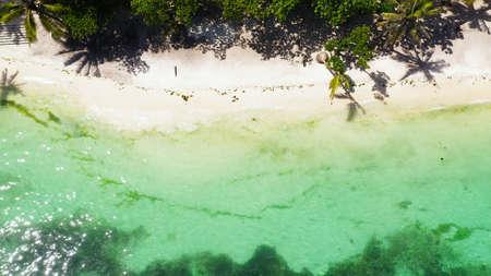 Beautiful tropical beach with white sand, palm trees, turquoise ocean. Alona beach, Panglao island, Bohol, Philippines.