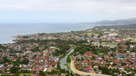 Panorama of the city of Iligan against the background of the sea and mountains. Iligan City, Lanao del Norte.