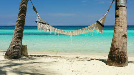 Hammock on sandy beach and turquoise water. Bohol, Panglao island, Philippines. Summer and travel vacation concept.