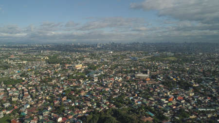 Aerial view of Manila city with skyscrapers and buildings. Philippines, Luzon. Aerial skyline of Manila.