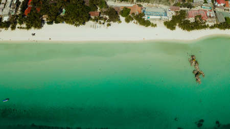 Topical white beach and Willys rock with tourists and hotels on Boracay Island. Aerial drone. Summer and travel vacation concept. Stock Photo