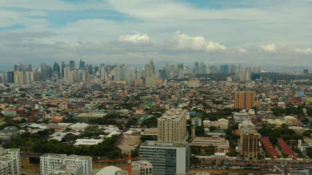 Populous city of Manila, the capital of the Philippines with skyscrapers, streets and buildings. Travel vacation concept.