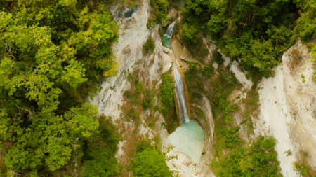 Aerial view of Dao waterfalls in a mountain gorge in the tropical jungle, Philippines, Cebu. Waterfall in the tropical forest.