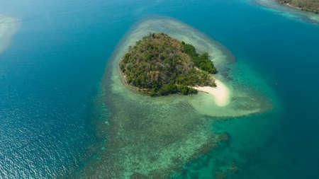Tropical island with sandy beach on the Zamboanga Peninsula. Sallangan Island. Mindanao, Philippines. Zdjęcie Seryjne