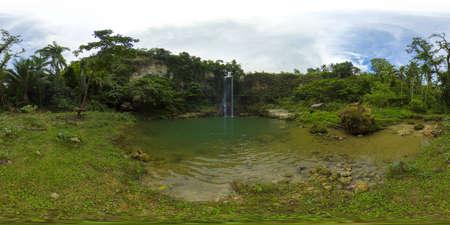 Beautiful waterfall in green forest. Tropical Kilab Kilab Falls in mountain jungle. Bohol, Philippines. Waterfall in the tropical forest. 360 panorama VR.