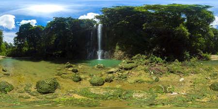Beautiful waterfall in green forest. Tropical Kawasan Falls in mountain jungle. Bohol, Philippines. Waterfall in the tropical forest. 360VR.