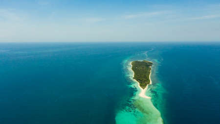 Travel concept: sandy beach on a small island Little Santa Cruz by coral reef atoll from above. Zamboanga, Mindanao, Philippines. Summer and travel vacation concept.