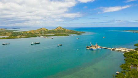 Cargo ships and tankers in the sea Harbour waiting for loading and unloading. Seaport, Tapal Wharf, Bohol, Philippines. Reklamní fotografie