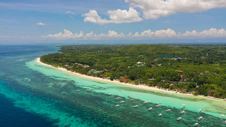 Coast with Sandy beach and turquoise water. Bohol, Panglao island, Philippines. Summer and travel vacation concept. Reklamní fotografie