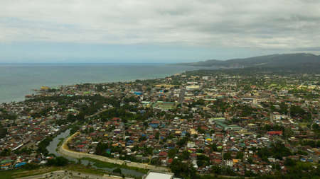 Cityscape of Iligan, with residential areas. Mindanao, Philippines. City in Asia view from above. Iligan City, Lanao del Norte. Reklamní fotografie