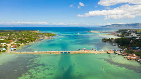 Aerial view of the Dauis bridge between Bohol and Panglao Islands. Bridge over the sea Strait with traffic and cars. Bohol,Philippines.