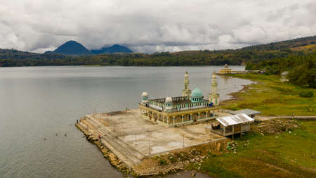 Mosque on the shore of lake Lanao view from above. Mindanao, Lanao del Sur, Philippines.