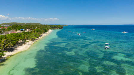 Beautiful Alona beach and blue sea in Panglao island, Bohol, Philippines. Holiday and vacation concept. Tropical beach.