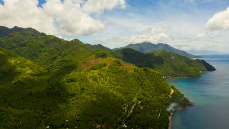 Aerial seascape: the coast of Leyte island with hills and mountains covered with green forest and jungle. Philippines.