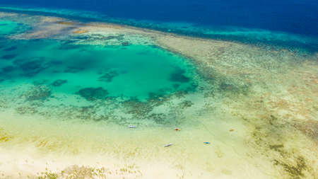 Atoll with turquoise water and boats view from above. Coral reef and blue sea. Coral reef and blue sea. Bohol,Philippines. Reklamní fotografie