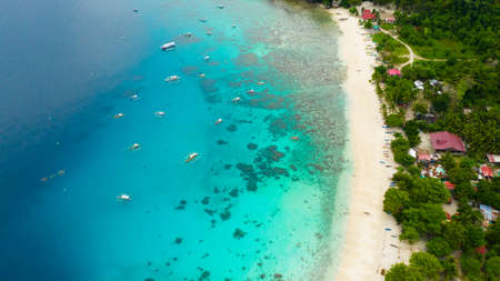 Sandy beach by atoll with coral reef and blue sea, aerial view. Alorro Beach, Philippines, Samal. Reklamní fotografie