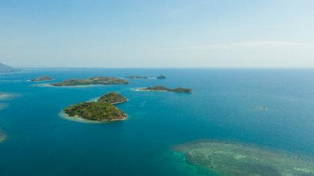 Islands with a sandy beaches and azure water. Lambang Island, Buguias Island. Zamboanga, Mindanao, Philippines.