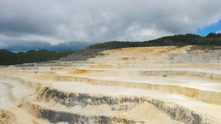 Aerial view of limestone quarry in the mountains among the rainforest. Bohol, Philippines.
