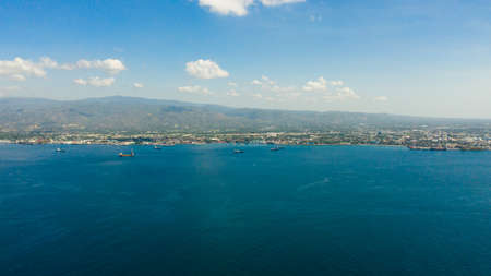 Aerial drone of Zamboanga city with its seaport and ships. Commercial and industrial center of the Zamboanga Peninsula Region. Mindanao, Philippines.