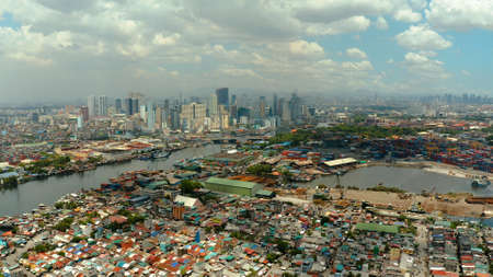 Cityscape of Makati with sea port,the business center of Manila, view from sea. Asian metropolis. Travel vacation concept.