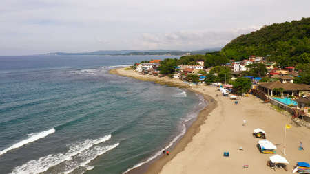 San Juan, La Union, Philippines. Sea coast with beach and hotels, top view. Beach for tourists. Summer and travel vacation concept. Stock Photo