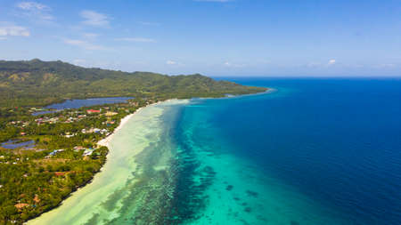 Beautiful tropical beach and turquoise water view from above. Bohol, Anda, Philippines. Summer and travel vacation concept.