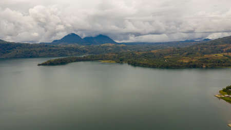 Top view of Lake Lanao surrounded by forest and mountains. Mindanao, Lanao del Sur, Philippines.