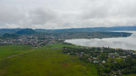 Aerial drone of Residential area of Marawi city with dense development, streets and residential buildings. Mindanao, Lanao del Sur, Philippines.