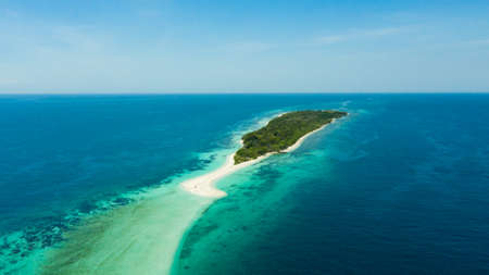 Tropical landscape: island with beautiful beach by turquoise water view from above.Little Santa Cruz island. Zamboanga, Mindanao, Philippines. Summer and travel vacation concept.